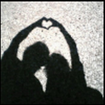 Picture of a couple making heart symbol with hands